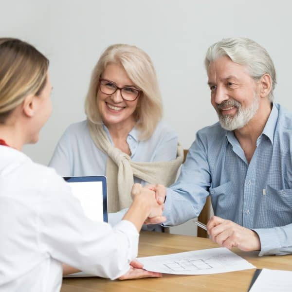 Stock photo of happy couple reviewing plans