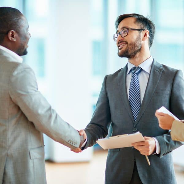 Stock image of three people shaking hands