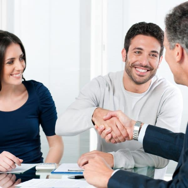 Couple meeting with professional to talk numbers