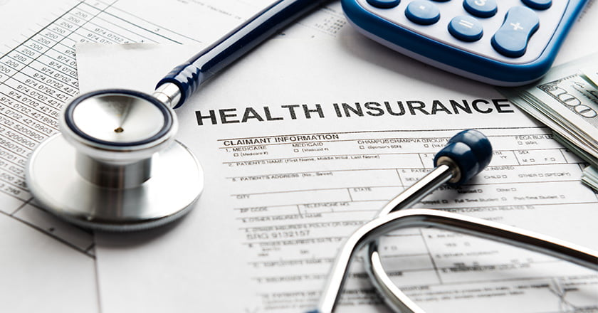 Health Insurance Documents, Stethoscope and money