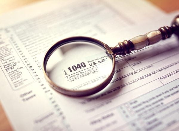 Tax Document 1040 with magnifying glass