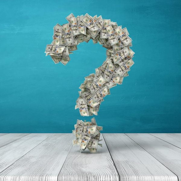 Money gathered in the shape of a question mark