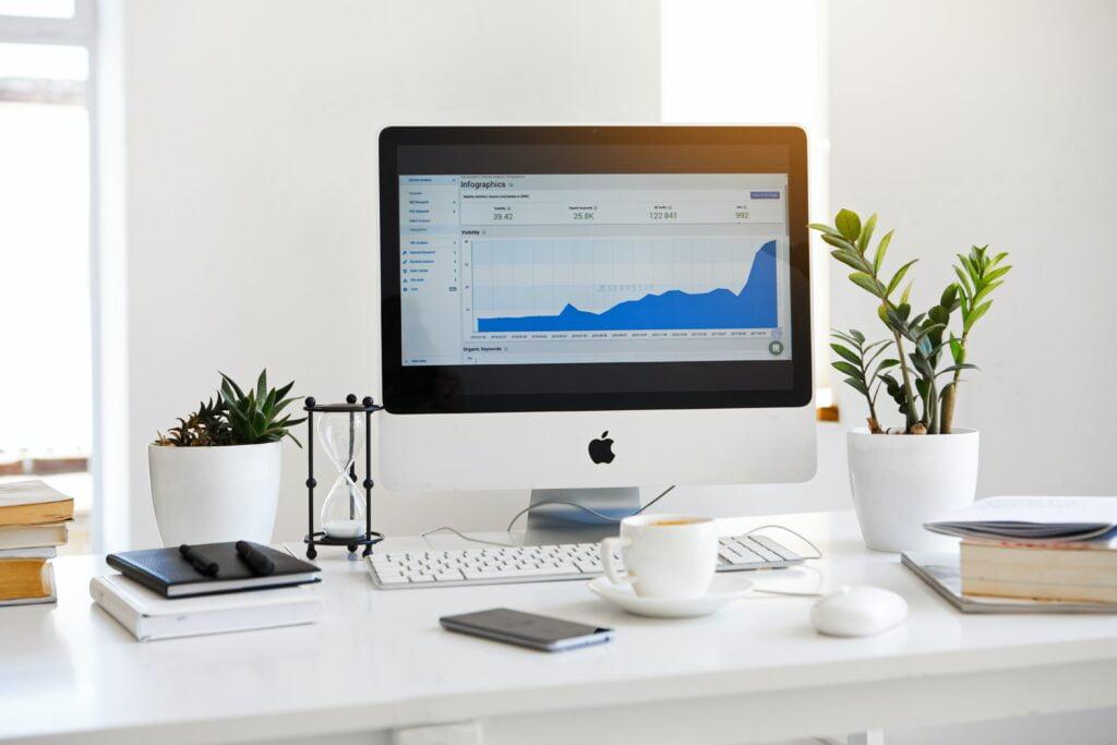 Apple desktop computer showing chart