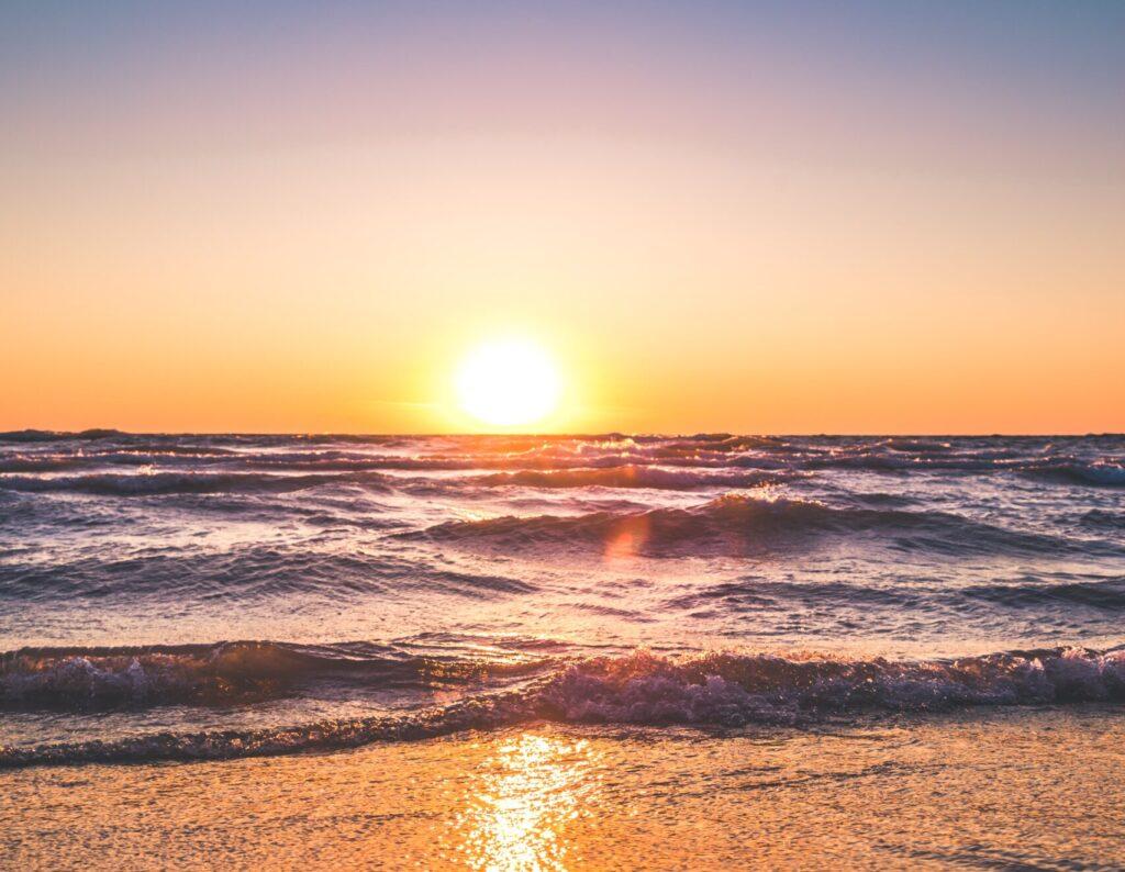 Beach sunset with ocean waves