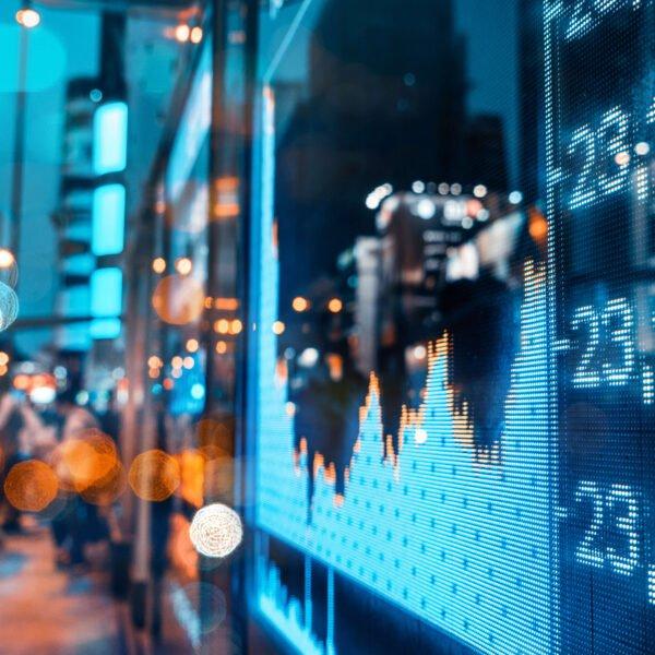 Graphic of big city Stock Market Updates sign
